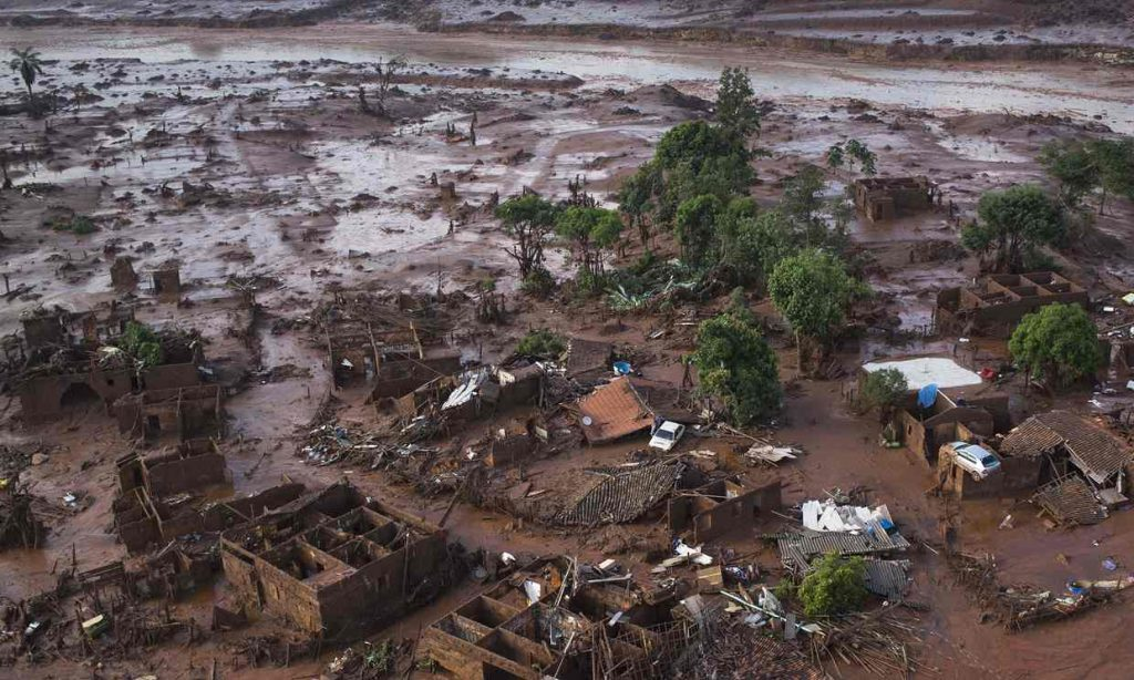 Homes lay in ruins on 6 November 2015 after two dams burst the previous day, flooding the small town of Bento Rodrigues in Minas Gerais state, Brazil. Photograph: Felipe Dana/AP