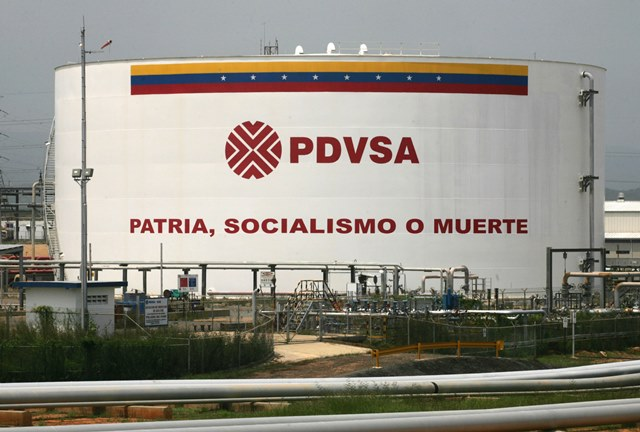 "An oil tank reads ""Fatherland, socialism or death"" in Ameriven company, part of the Complex Jose in Anzoategui state, 200 miles East from Caracas, Venezuela. The complex, that make refined crude from the heavy oil of the Orinoco Belt, is a joint venture between Venezuelan state owned PDVSA and the foreign companies Chevron, British Petrolum, Total and Statoil. May 1st 2007 Venezuelan President Hugo Chavez changed the stock holding of the complex to make PDVSA ,with 60 percent of the stocks , control the participating companies. Photographer Diego Giudice/Bloomberg News"
